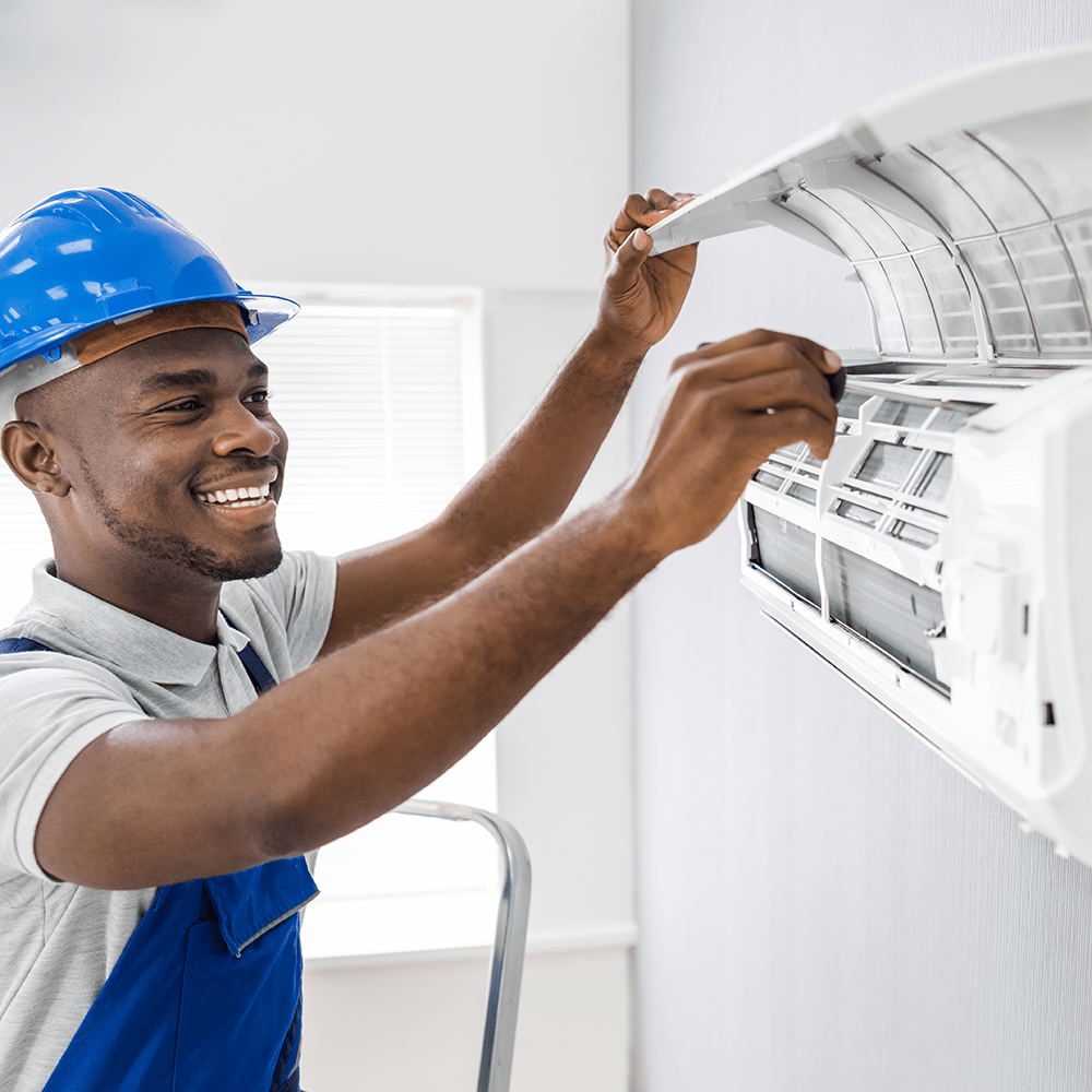 join our team hvac guy repairing ductless system